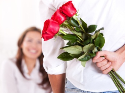 Man-Giving-Flowers-to-Woman